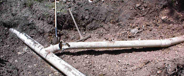 broken lateral line causing backups in septic tank