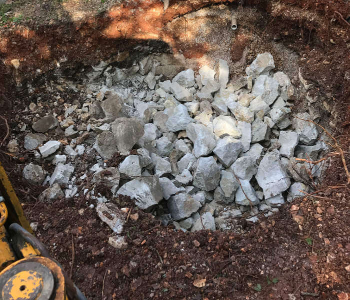 rock breaking with backhoe for larger hole to install new septic tank 1-2-2017