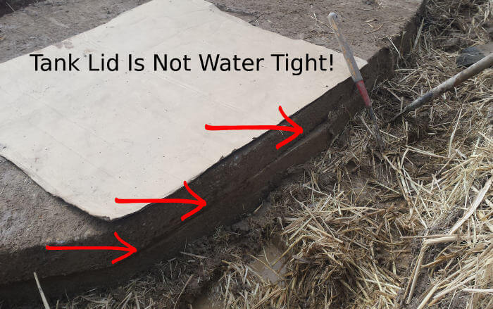septic tank lid not water tight causing backups