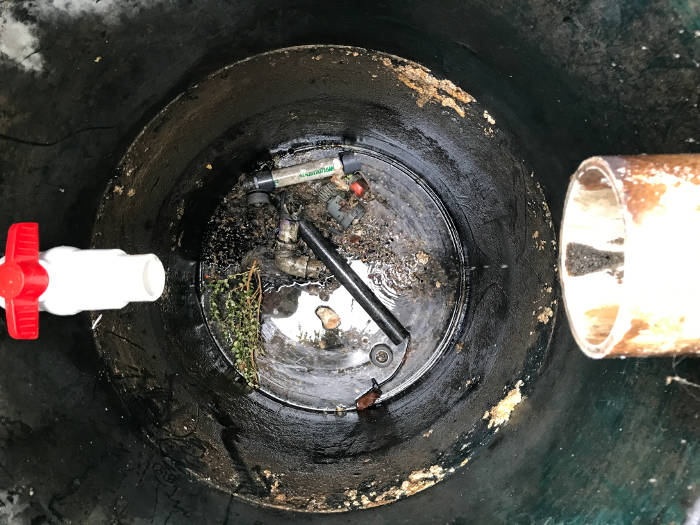 misc parts left over in bottom of grinder pump basin from previous installation 9-29-17